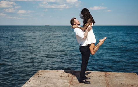 Guy and girl on the sea pier