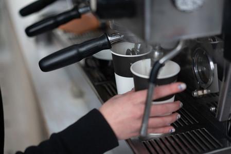 Barista woman make a coffee
