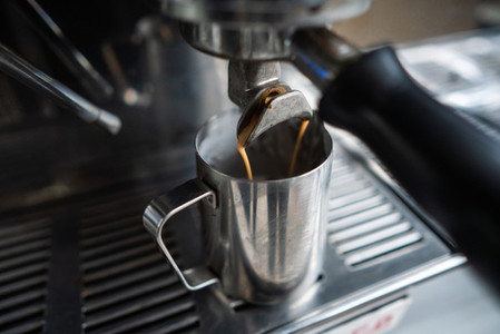 make espresso with a coffee machine