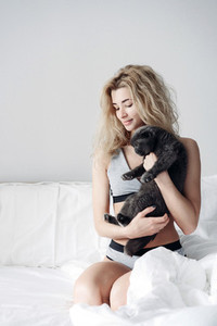 Happy young woman hugging a cat