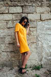 Attractive fashion woman in yellow dress