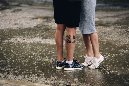 couple on the background of wet asphalt