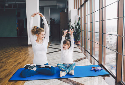 Mother and daughter makeing yoga