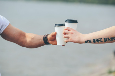 cheers using two cups of coffee