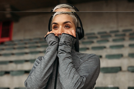 Close up of a woman in the stands of a stadium