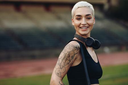 Portrait of a smiling female runner