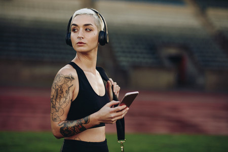 Portrait of a female athlete in a stadium