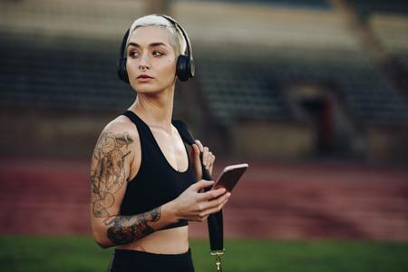 Portrait of a female athlete in a stadium