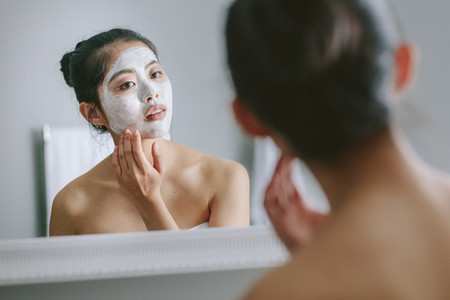 Woman doing beauty treatment in bathroom
