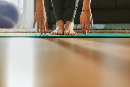 Girls hands and feet during yoga workout