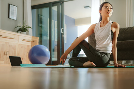 Asian woman practicing yoga for good health