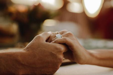 Romantic couple holding hands
