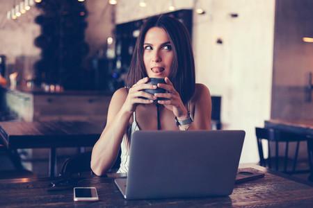 woman uss laptop