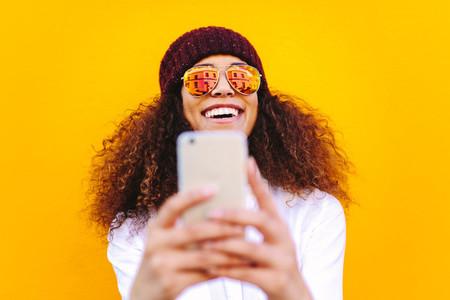 Stylish african woman making selfie