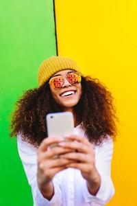 Beautiful african girl taking selfie