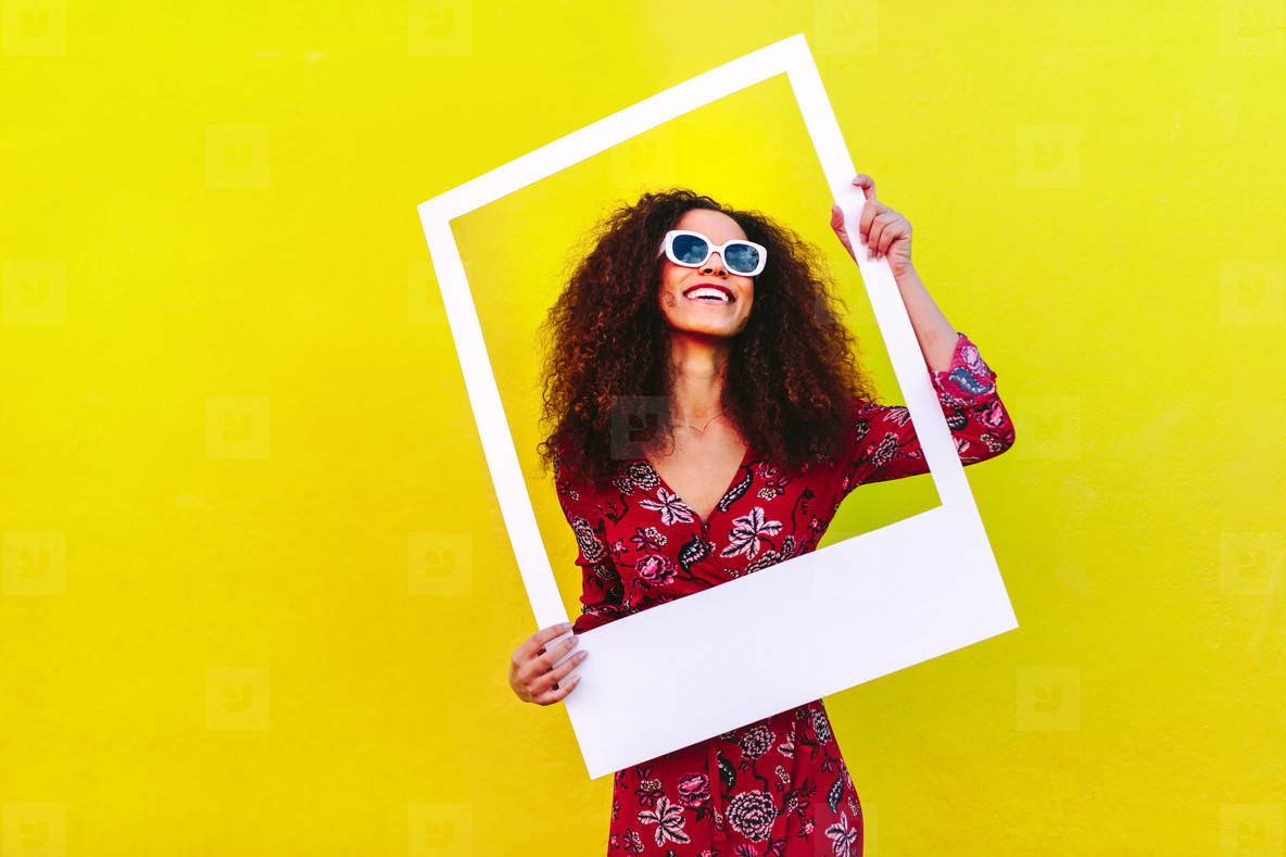 Beautiful woman with blank picture frame