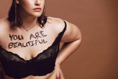 Oversize woman in black bra
