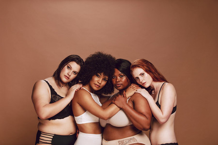 Group of different size women in lingerie