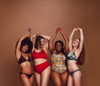 Multi ethnic women in swimwear enjoying themselves