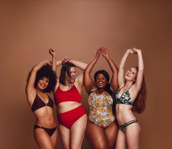 Multi ethnic women in swimwear enjoying themselves