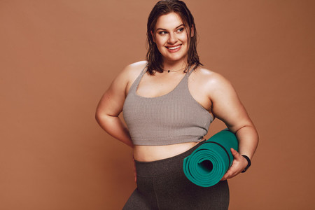 Plus size female model after yoga workout