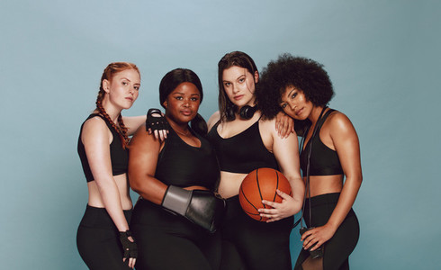 Diverse group of women with sports equipment