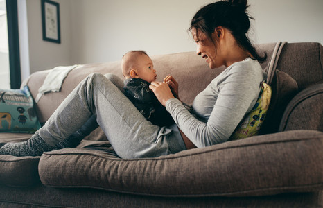 Mother spending time talking to her baby at home