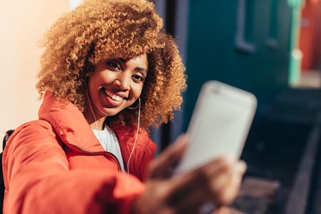 Smiling afro american tourist taking a selfie