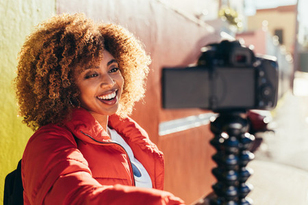 Portrait of a female traveller taking a selfie