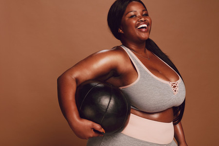 Plus size female with medicine ball