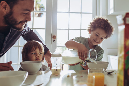 Father having breakfast with his kids at home