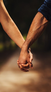 Loving couple holding hands in the park