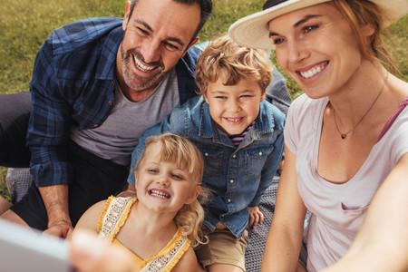 Family talking selfie  on picnic