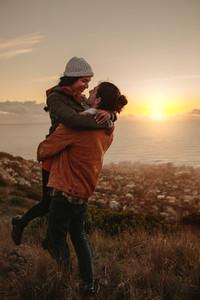 Traveling couple on mountain peak
