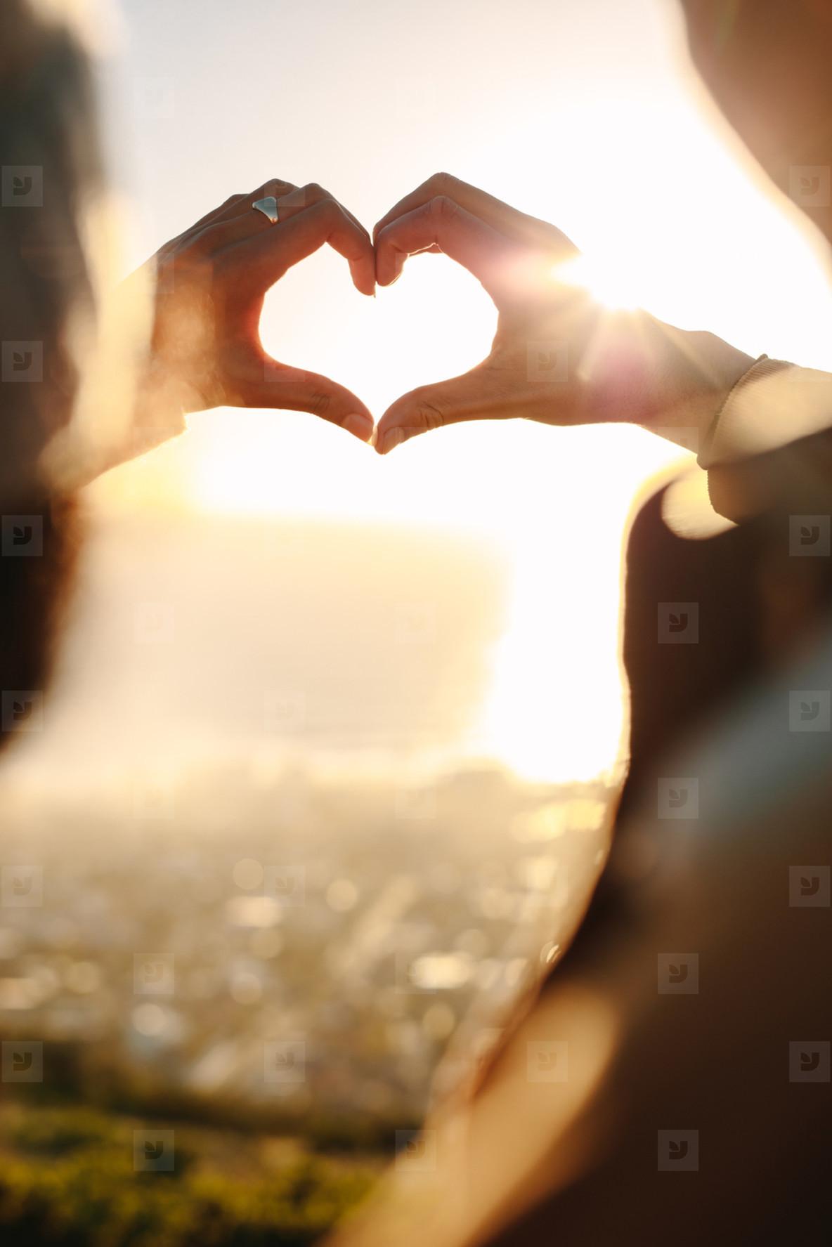 Romantic couple making a finger heart