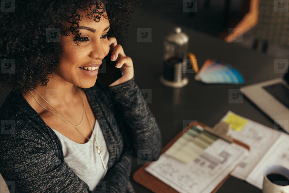 Female architect talking with client over phone