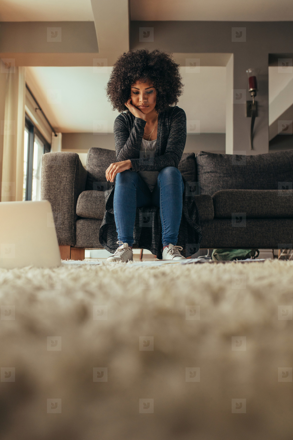 Woman looking at documents on floor