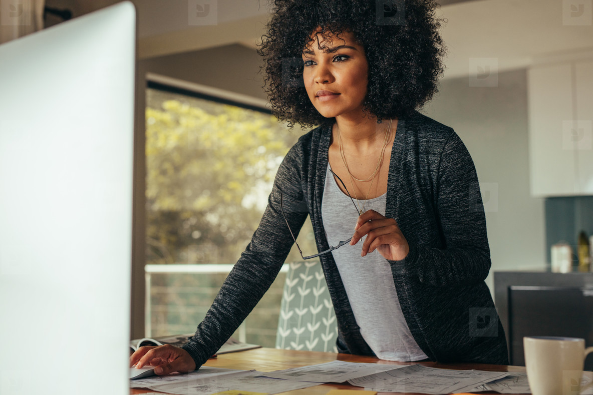 Female interior designer working on computer