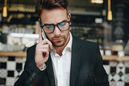 Portrait of an entrepreneur talking on cell phone