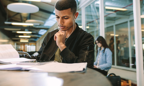 Male student studying at college campus