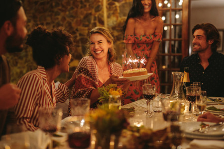 Beautiful woman celebrating her birthday with her friends