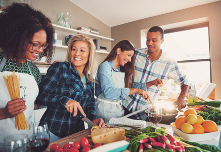 Four friends at sunlit kitchen