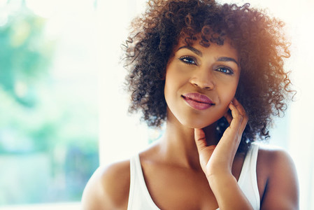 Pretty afro american woman smiling at camera