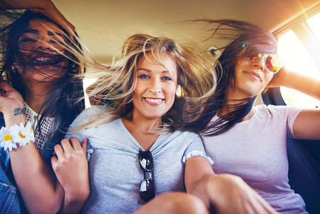 Girlfriends travelling with the wind in their hair