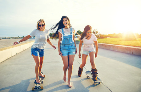 Three active young woman on a day at the seaside