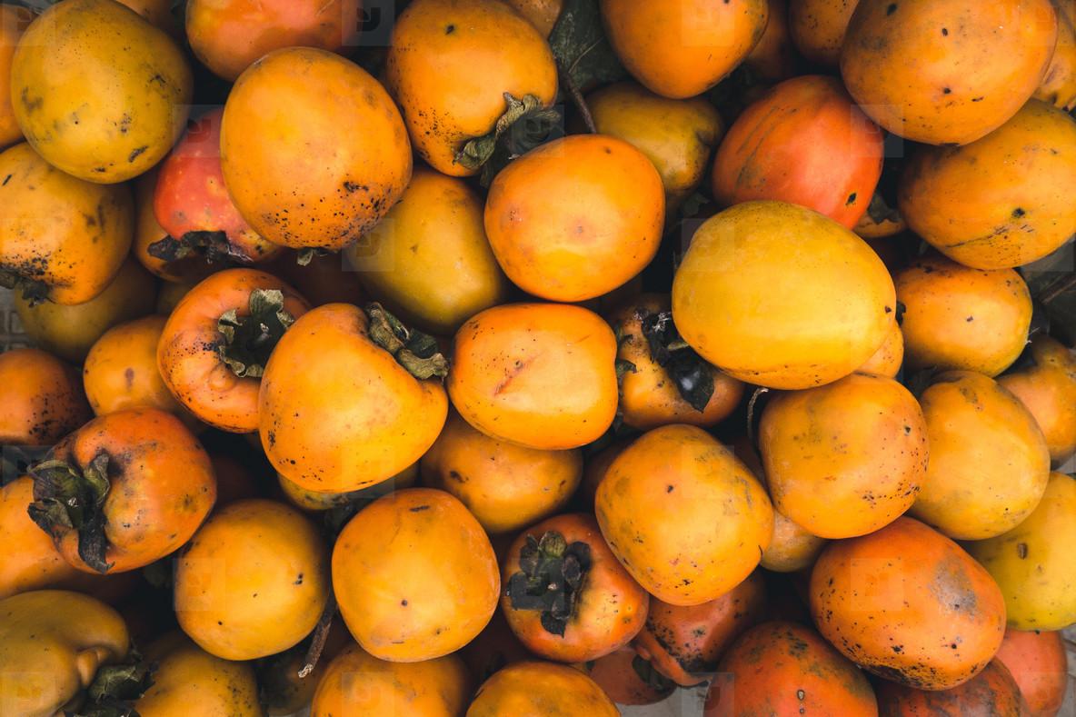 Orange kaki fruit aerial