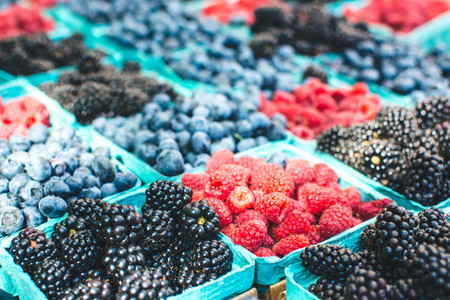 Packets of berries at market