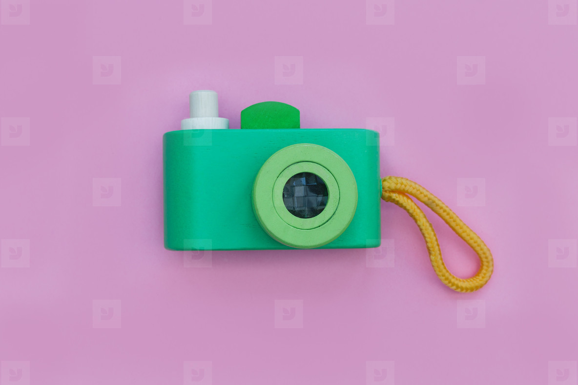 Toy camera on pink color background