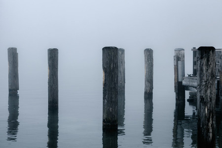 Views of the wooden pier in the mist on the Konigsee lake of Germany