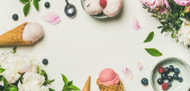 Flat lay of ice cream scoops and peonies wide composition
